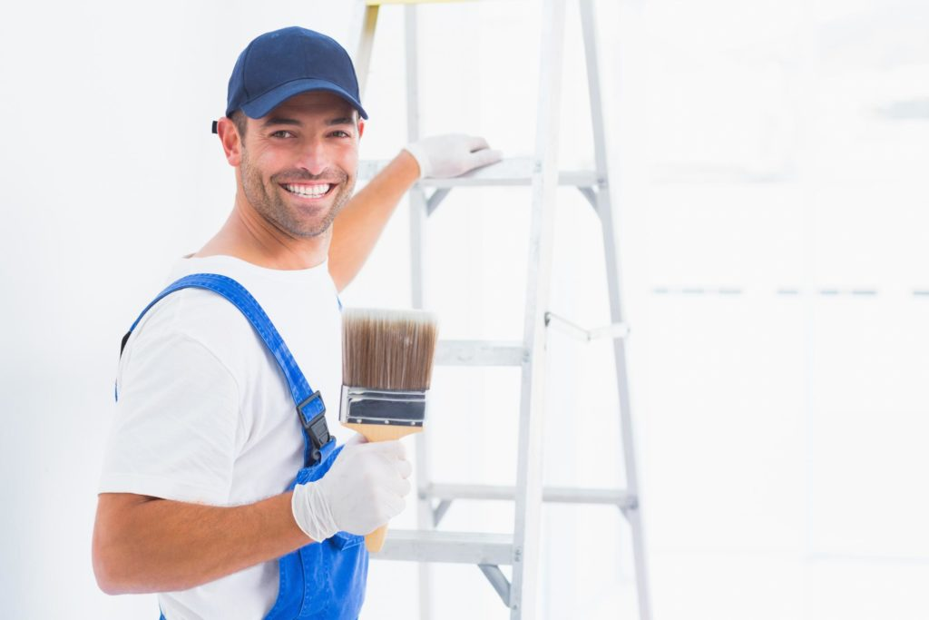 painter holding a paint brush
