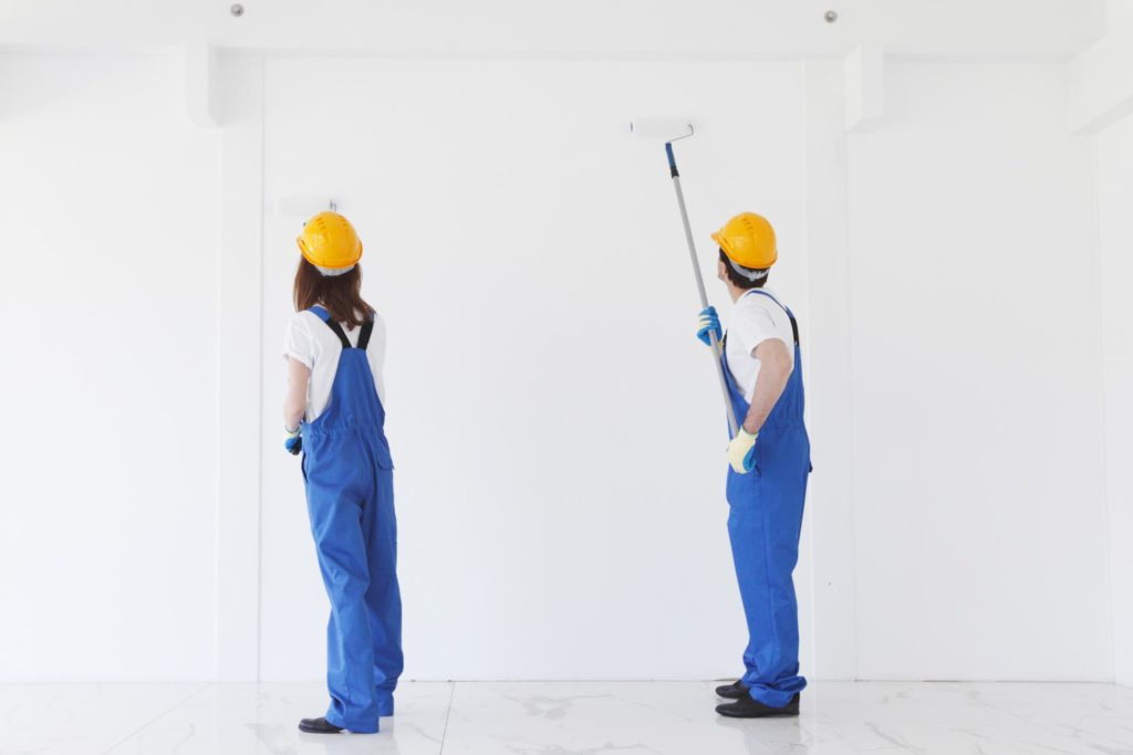 painters are painting the wall